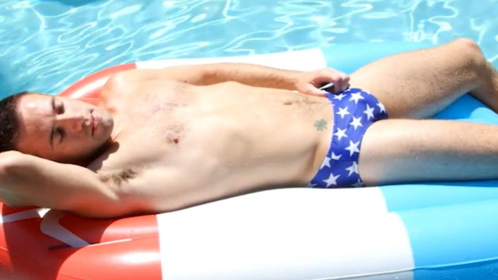 gay stud in swimming trunks by pool