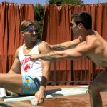 gay bathing suit dudes play by pool